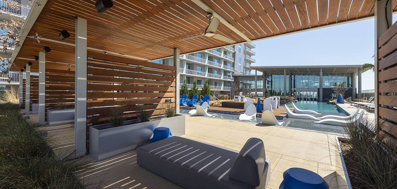Outdoor lounge cabana with comfortable outdoor furniture, built in speakers and fans.